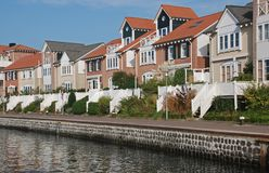 Modern houses view waterfront stock images