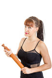 Modern housewife holding rolling pin wearing black dress Royalty Free Stock Photo