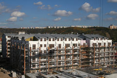 Modern housing. Construction of modern block of flats Stock Images