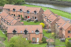 Modern housing development by river Stock Photo
