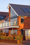 Modern housing solar panels Royalty Free Stock Images