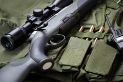 Hunting rifle and equipment. Modern hunting rifle with optical sight and equipment Royalty Free Stock Photos