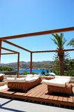 Modern hut and sunbeds at luxury hotel Stock Photography