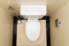 Modern and hygienic toilet bowl with bidet in bathroom with cover closed Stock Image