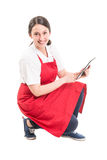 Modern hypermarket female worker using tablet Royalty Free Stock Photography