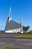 Modern Iceland Church on bright blue sky background Stock Photos
