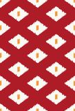 Modern ikat tribal seamless pattern. For web design, home decor, or fashion illustration. In deep red, white and orange Royalty Free Stock Photos