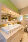 Modern illuminated washroom interior Royalty Free Stock Photography