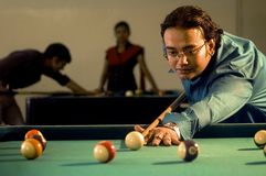Modern India youth. An Indian young man is playing Snooker in Club Stock Photo