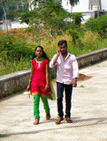 Modern Indian boy and girl. India, Karnataka - January 17, 2016: Good couple. Modern Indian boy and girl. Girl with national dress style, but with new elements Royalty Free Stock Photos