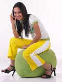 Modern indian girl saying excellent. Sitting on the cushion Royalty Free Stock Image