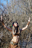 Modern Indian-style girl in a horned and feathered hat. Dancing tribal and shamanic ritual dances Stock Images