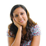 Modern Indian woman. Portrait of a modern Indian woman smiling, isolated on white background Royalty Free Stock Photos
