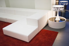 Modern_indoor. Modern white colored furniture in living room setting Royalty Free Stock Photos