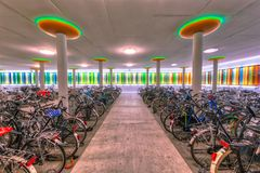 Modern indoor bicycle parking. At a train station in the Netherlands Royalty Free Stock Photo