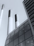 Modern industrial building with glass chimneys and s Royalty Free Stock Photo
