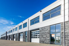 Modern industrial building with loading doors and blue sky Royalty Free Stock Image
