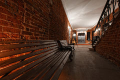 Modern industrial creative workspace. staircase with textured brick walls to the attic loft Royalty Free Stock Images