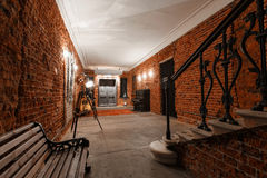 Modern industrial creative workspace. staircase with textured brick walls to the attic loft Royalty Free Stock Photo