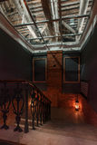Modern industrial creative workspace. staircase with textured brick walls to the attic loft Stock Photography
