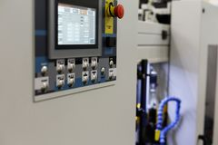Modern industrial equipment with CNC control panel royalty free stock image