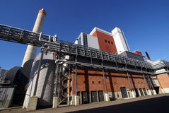 Modern industrial factory against blue sky Stock Photo