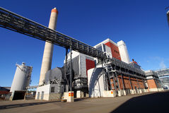 Modern industrial factory with smokestack blue sky. Modern industrial factory against blue sky royalty free stock images
