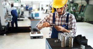 Modern industrial machine operator working in factory stock photo