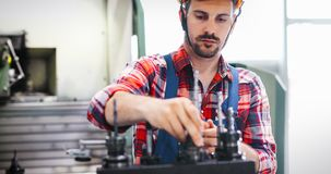 Modern industrial machine operator working in factory royalty free stock photography