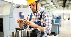 Modern industrial machine operator working in factory royalty free stock photos