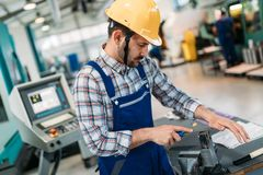 Modern industrial machine operator working in factory royalty free stock images