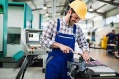 Modern industrial machine operator working in factory Stock Photo