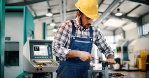 Modern industrial machine operator working in factory royalty free stock photo