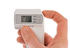 Modern infra-red digital thermometer with hand Stock Photos