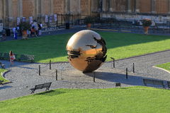 Modern installation Sphere within Sphere by Arnaldo Pomodoro Stock Photos