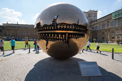 Modern installation Sphere in Vatican. VATICAN - CIRCA SEPTEMBER 2014: Modern installation Sphere within Sphere by Arnaldo Pomodoro in Belvedere Courtyard stock photography