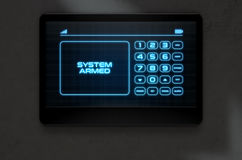 Modern Interactive Home Security. A 3D render of a modern touch screen interactive home security keypad access panel with an illuminated digital numeric keypad Royalty Free Stock Photography