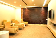 Modern interior. Contemporary corporate gallery with sofas, table, chairs and places for exposition of artworks Stock Photos