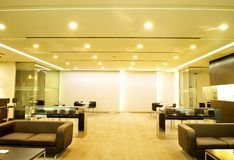 Modern interior. Contemporary corporate gallery with sofas, table, chairs and places for exposition of artworks Stock Images