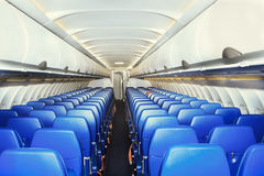 Modern interior of the airliner. Modern interior of the empty airliner Royalty Free Stock Photography