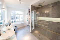 Modern interior of a  bath room with big shower cabin stock photos