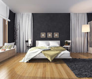 Modern interior of a bedroom with a wall of dark color, bed and. The bedroom in the interior of the apartment. At the center of the room is the bed. On the bed Stock Image