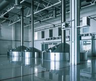 Modern interior of a brewery mash vats metal containers Royalty Free Stock Images