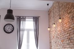 Modern interior with brick wall loft lamps stock images