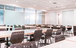 Modern interior of cafeteria or canteen with chairs and tables Royalty Free Stock Photos