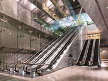 Modern interior of changi international airport. Modern interior facade with long escalators and glass walls Royalty Free Stock Images
