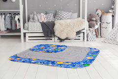 Modern interior of the child`s bedroom with carpet in front Royalty Free Stock Photos