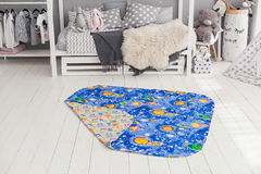 Modern interior of the child`s bedroom with carpet in front Royalty Free Stock Photo