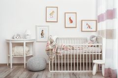 Modern interior of child`s room with pictures. Modern interior of child`s room with animal pictures stock photography