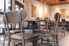 Modern interior of coffee shop decorate with wooden furniture Royalty Free Stock Image